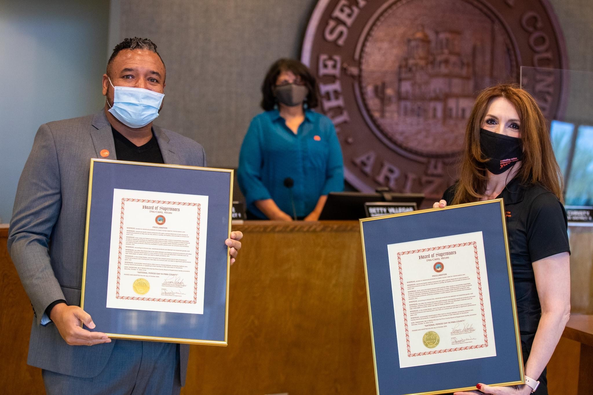YWCA and Diaper Bank CEO's accepting period day proclamation