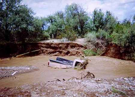 Vehicle stuck in the Franco Wash during a flood.