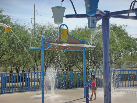 child in splash pad