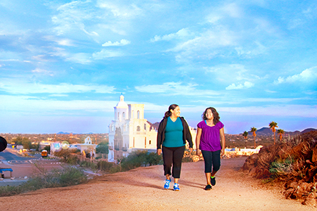 Two women walking near San Xavier Mission
